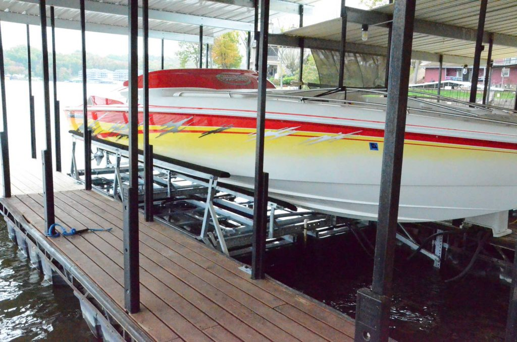 Large speed boat docked on a boat lift at Lake of the Ozarks