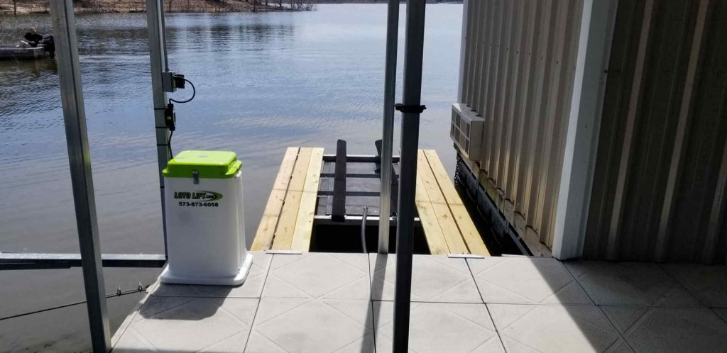 Single jet ski lift with a control box on the dock.