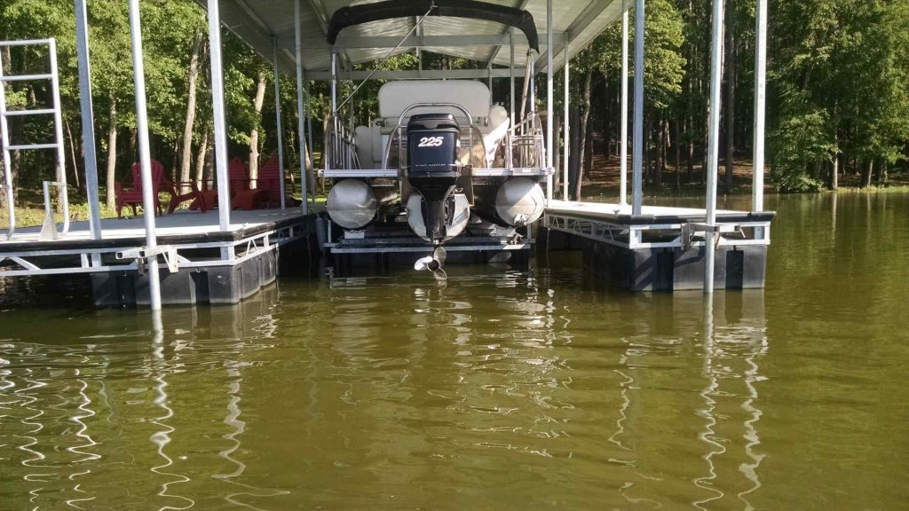 Pontoon boat on a LOTO Lift shallow water lift at Lake of the Ozarks.