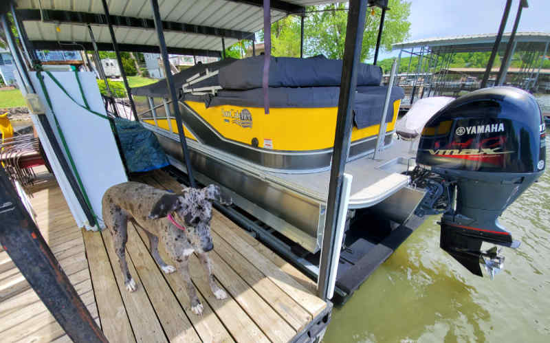 Boat up on a pontoon boat lift at Lake of the Ozarks in Missouri