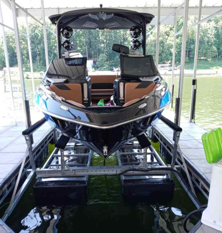 Front view of a boat docked on a lift.