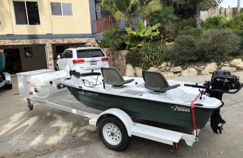 Small plastic fishing boat on a boat trailer