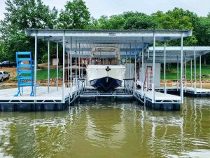 Large boat on a private boat dock lift at Lake of the Ozarks in Missouri